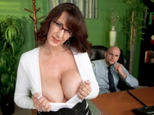 Fucking the huge-titted M.I.L.F. who's wearing glasses